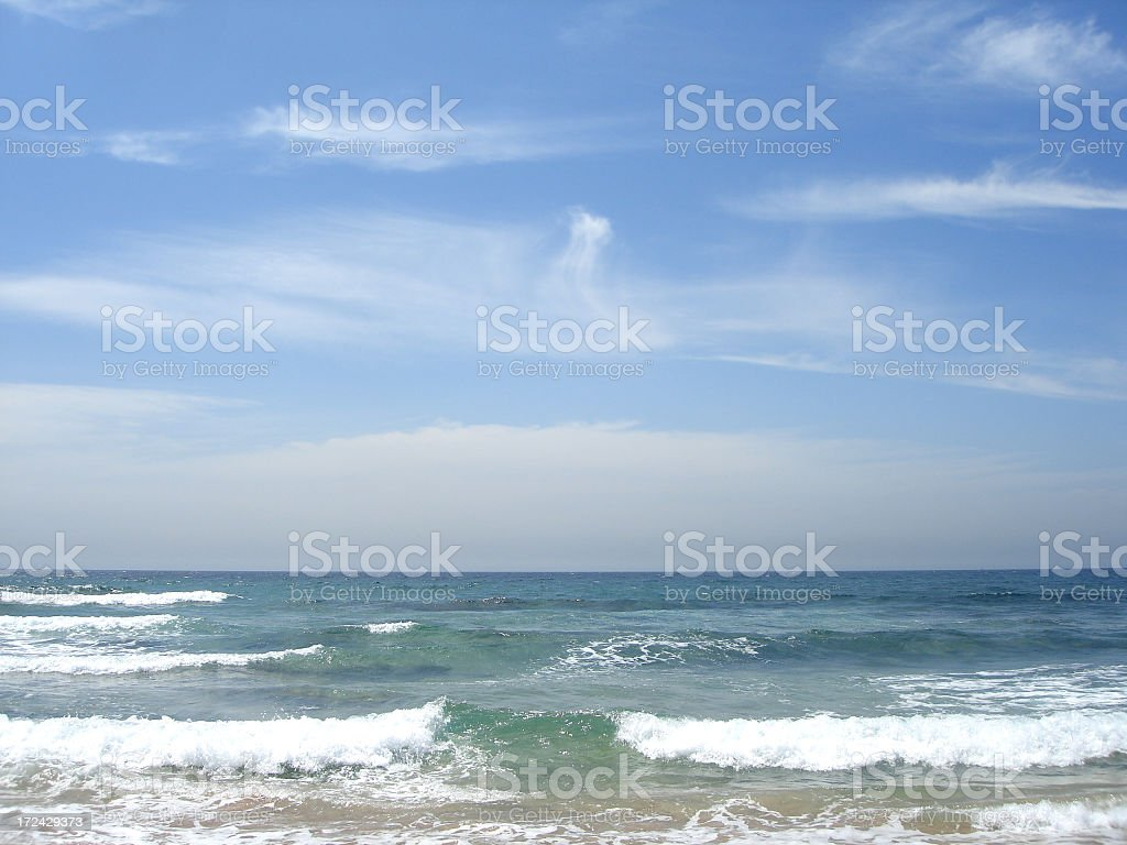 Sea waves at beach on a sunny day stock photo