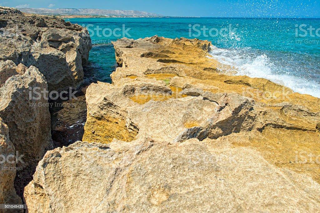 sea waves on lava rocks shore stock photo