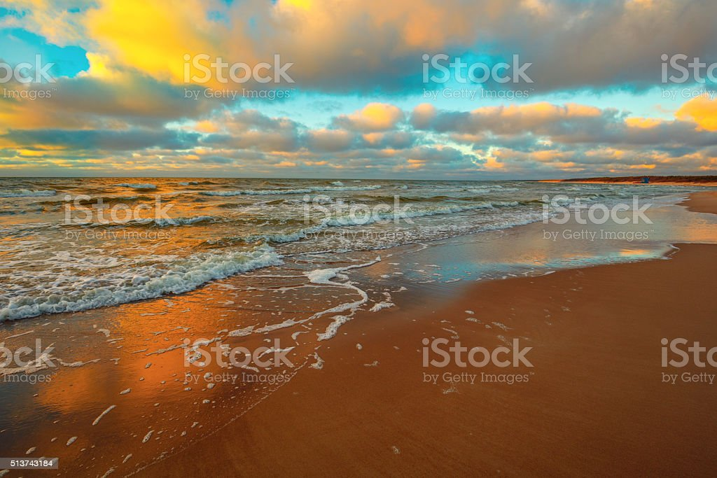 Sea with cloudy sky in evening at sunset stock photo