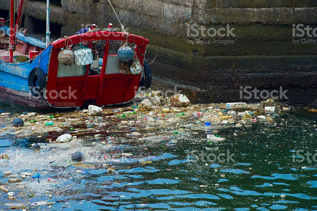 sea with no proper trash collection or recycling. stock photo