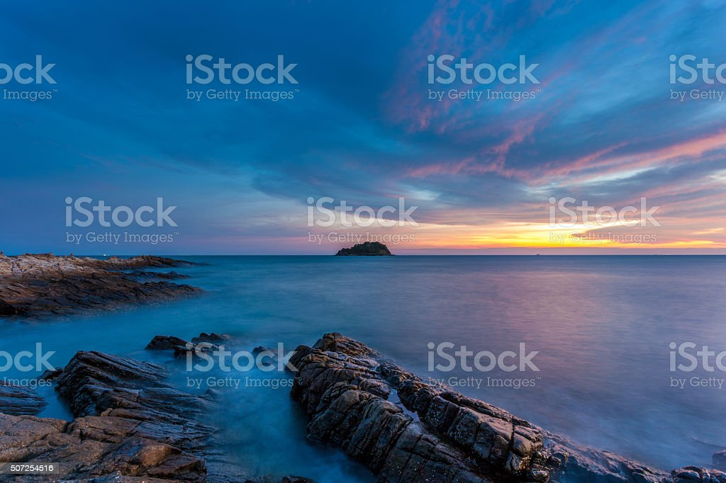 sea with rocks and sunset glow stock photo