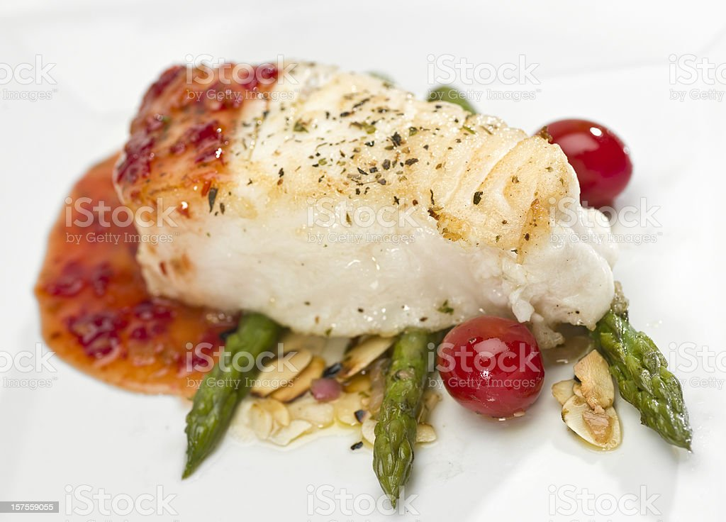 Seabass Fillet of  in sweet and sour sauce with asparagus stock photo
