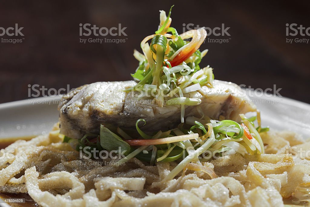 Seabass with sauce and crispy noodle royalty-free stock photo
