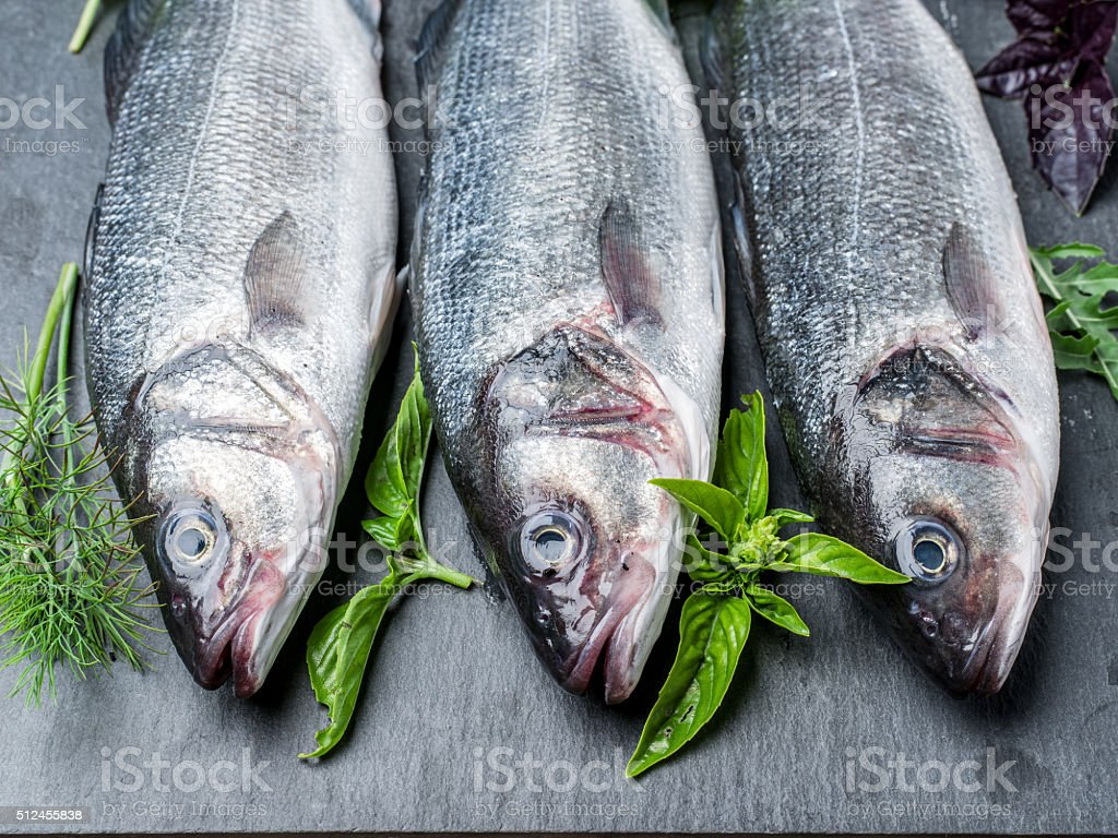 Seabass with spices and herbs. stock photo