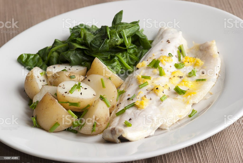 Seabass with spinach royalty-free stock photo