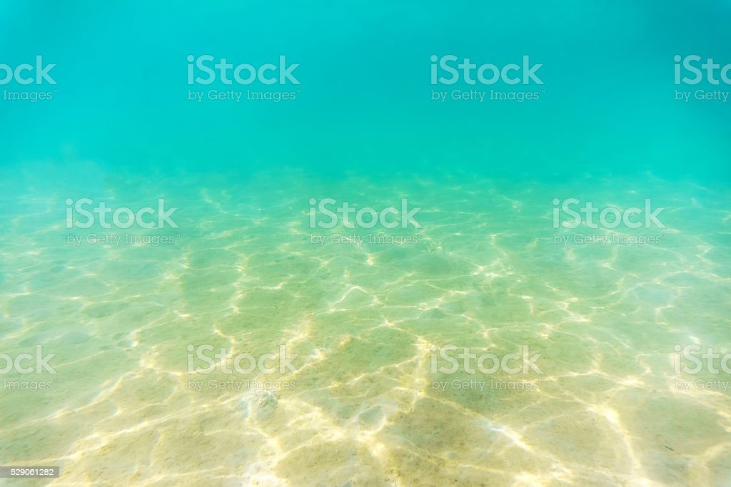 Seabed with sunlight reflextion stock photo