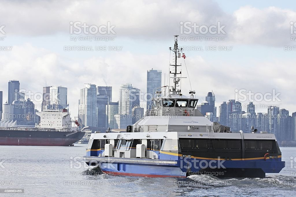 SeaBus and Vancouver Skyline, Burrard Inlet, British Columbia, Canada royalty-free stock photo