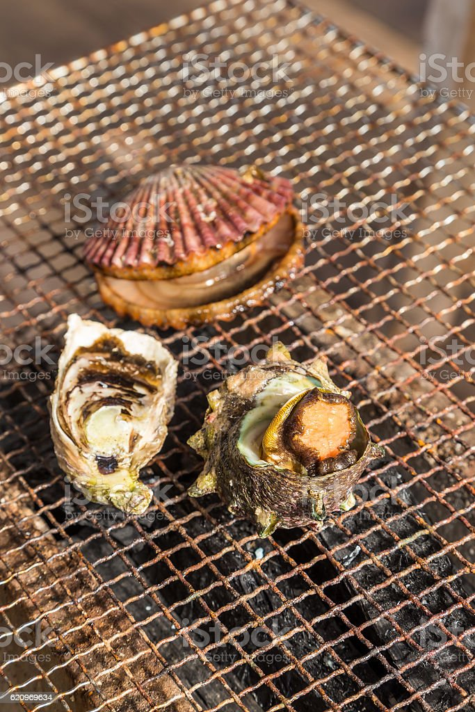 Seafood barbecue - Oyster and scallop grill stock photo