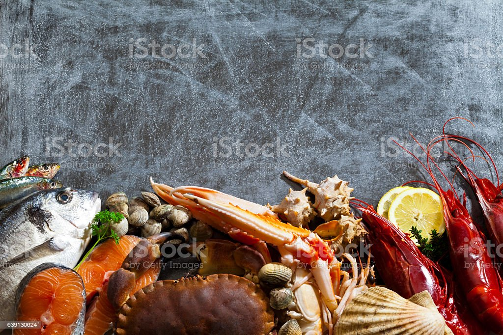 Seafood border with dark copy space stock photo