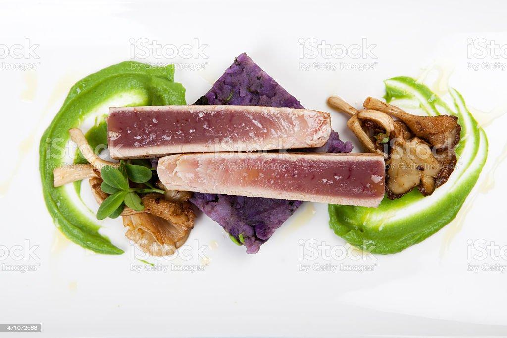 seafood dinner with tuna fillet, mushy peas, mushrooms and potatoes stock photo