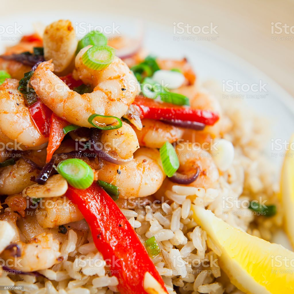 Seafood fried rice - king prawns, spring onions, chives, peppers. stock photo