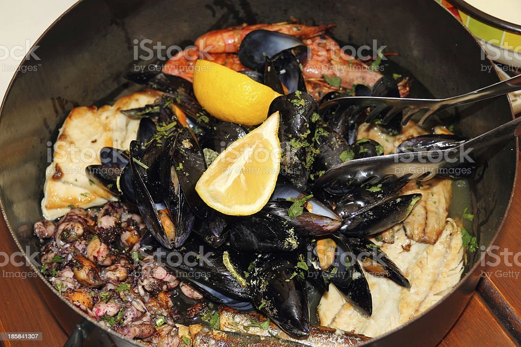 Seafood in the pot stock photo