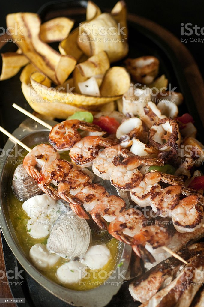 A seafood meal combo with skewers stock photo