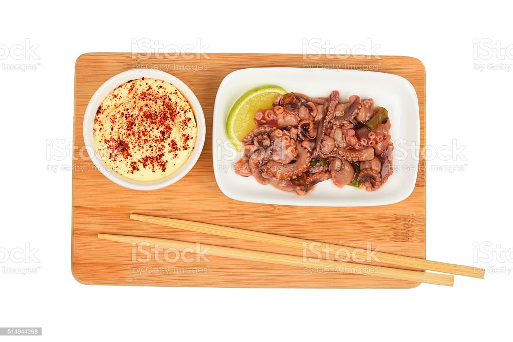 Seafood octopus salad and sauce on wooden board royalty-free stock photo