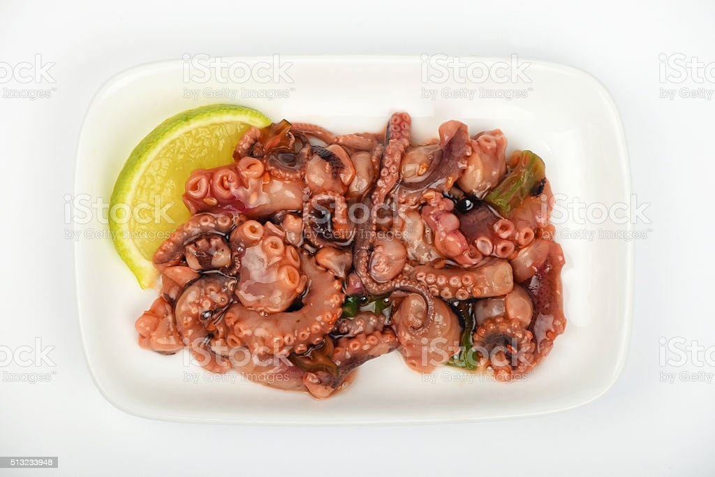 Seafood octopus salad snack on white plate royalty-free stock photo