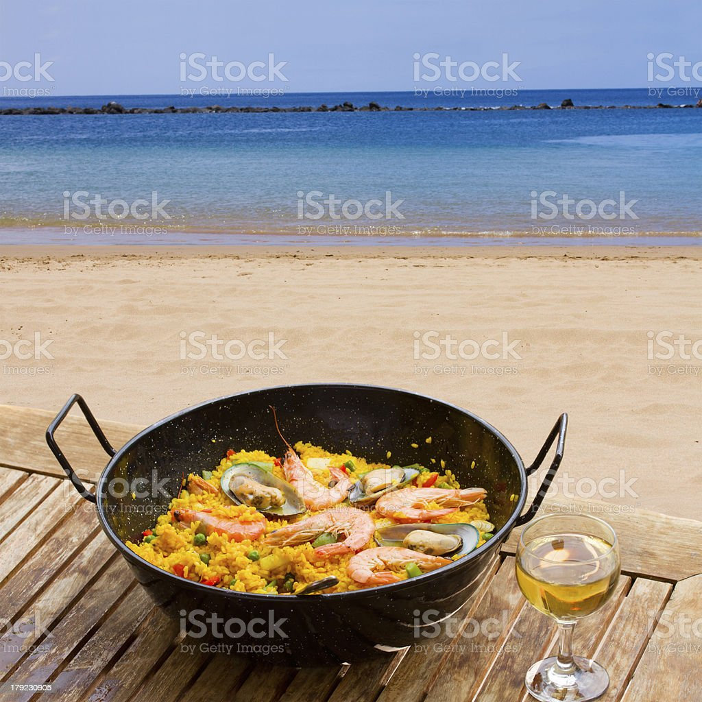 Seafood paella in seaside cafe stock photo