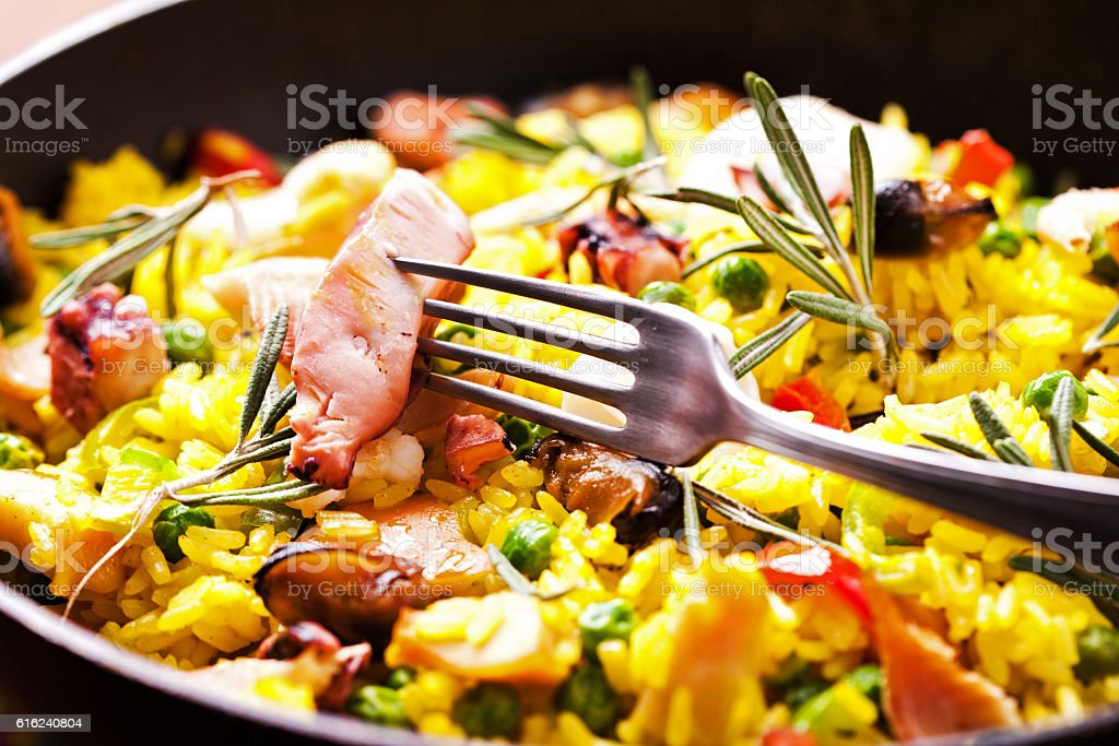 Seafood paella in the fry pan stock photo