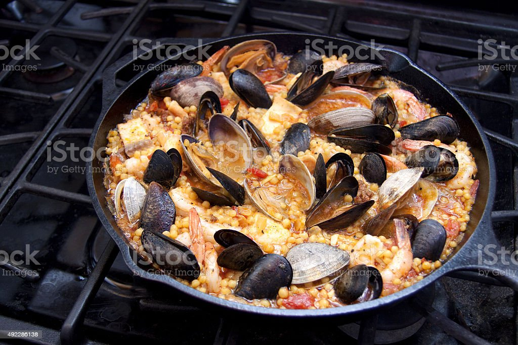 Seafood paella with Israeli Cous Cous stock photo