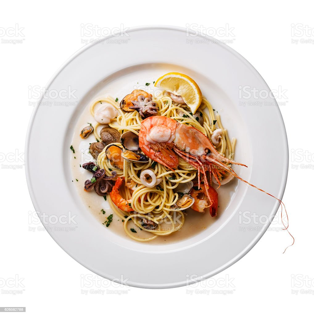 Seafood pasta Spaghetti on plate isolated stock photo