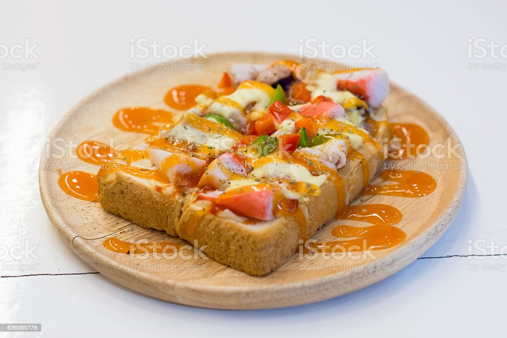 Seafood pizza in wood dish stock photo