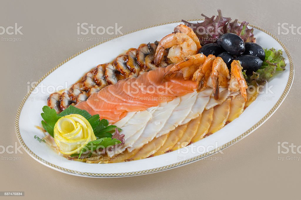 Seafood platter garnished with greens and olives stock photo