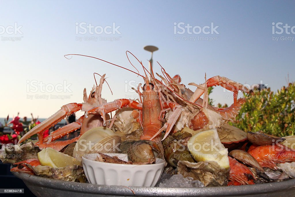 seafood platter, seaside, blue sky, port, horizontal stock photo
