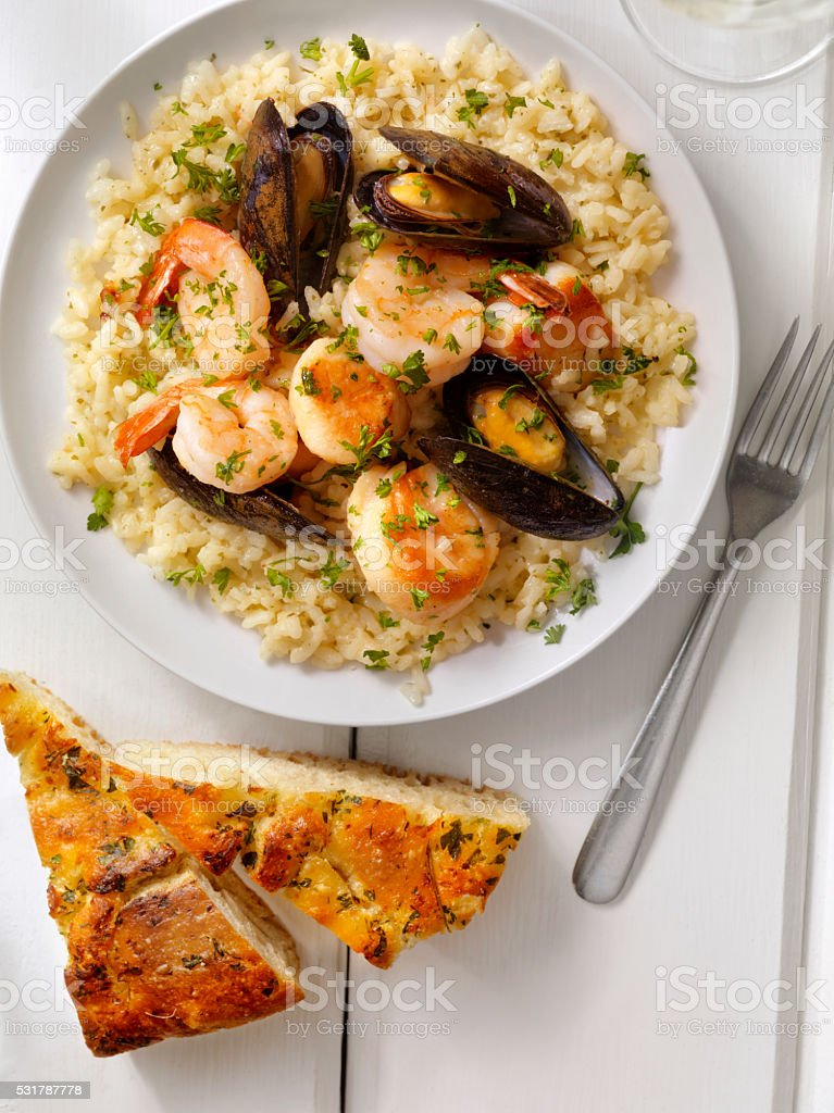 Seafood Risotto with Fresh Parsley stock photo