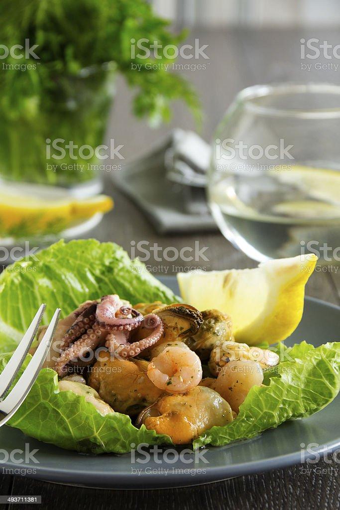 Seafood salad and lemon. royalty-free stock photo