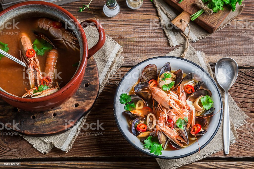 Seafood soup with mussels and langoustines stock photo