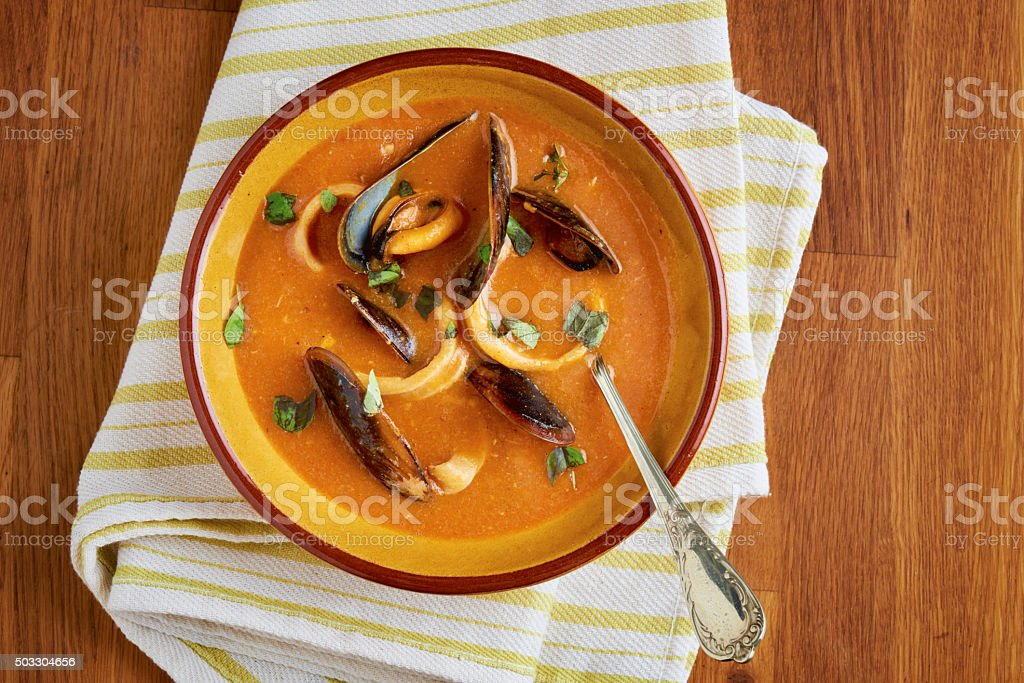 Seafood soup with mussels, fish and calamari rings stock photo