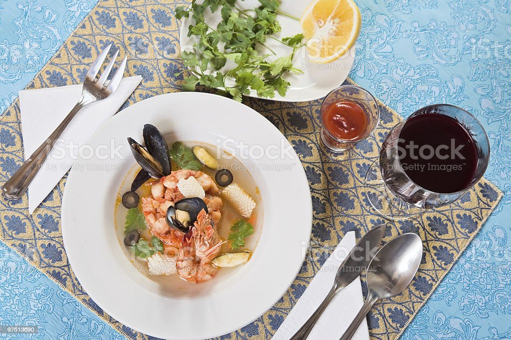 Seafood soup with shrimps and mussels on blue royalty-free stock photo