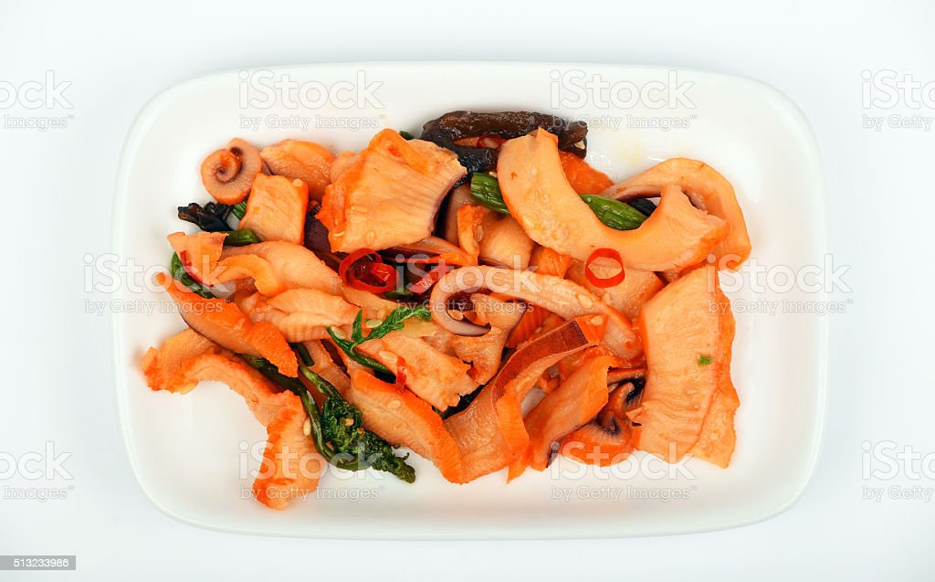 Seafood squid salad on white plate royalty-free stock photo