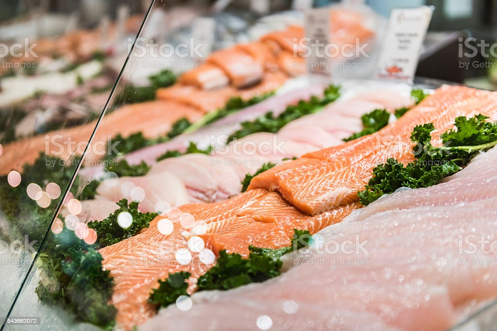 Seafood stand with cuts and filets of salmon and tuna stock photo