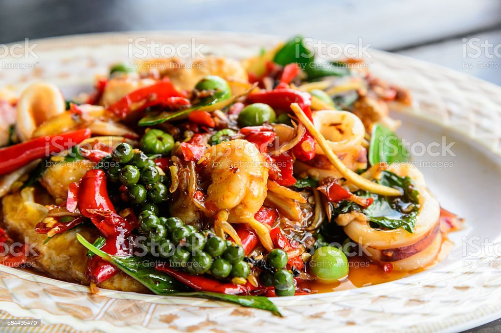 seafood stir fried with Thai herb stock photo
