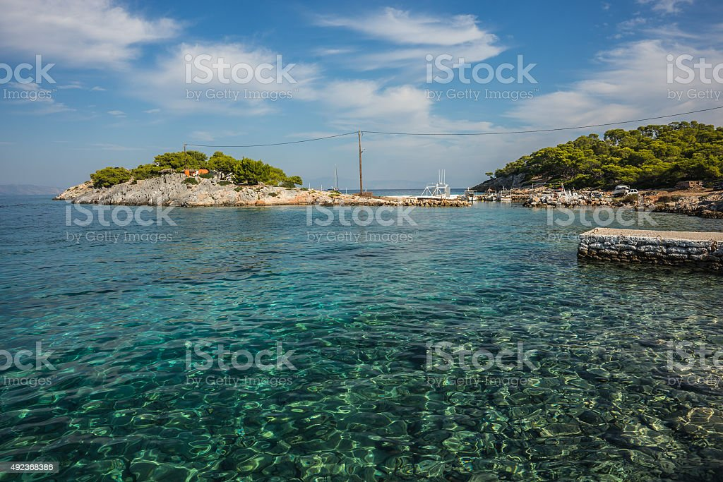 Seafront and  beach near  town of Scala, Agistri Island,  Greece stock photo