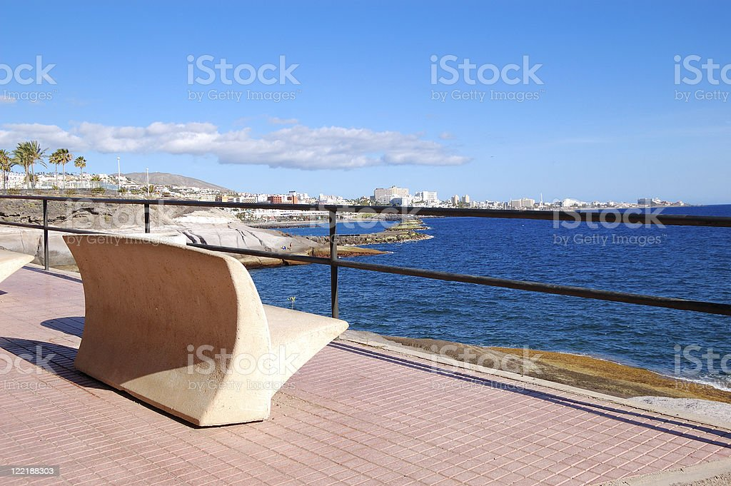 Seafront and bench at Playa de las Am?ricas stock photo