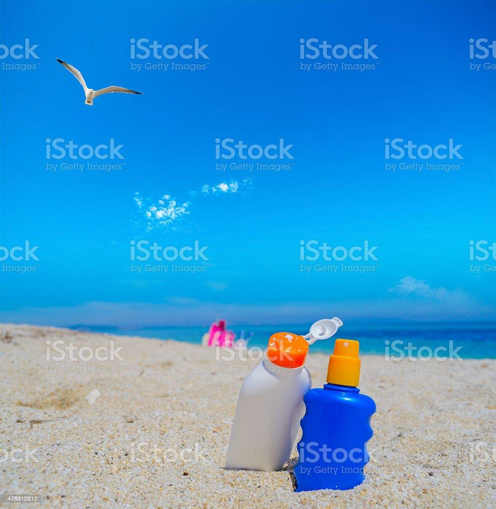 seagull flying over the suntan lotion bottles stock photo