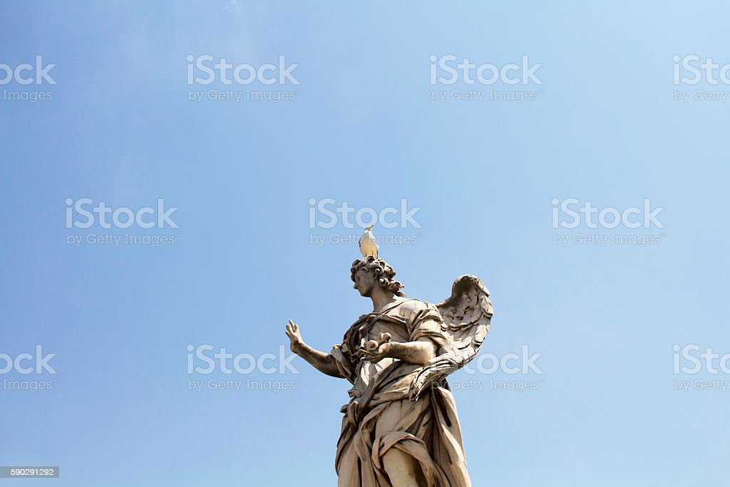 Seagull on top of statue at St. Angelo Bridge stock photo