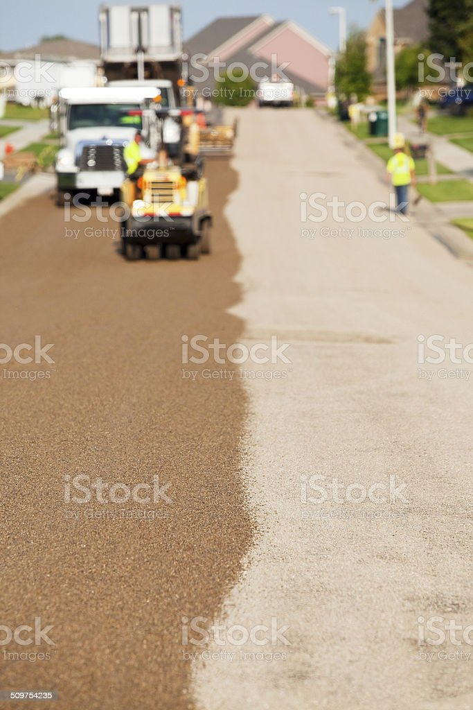 Seal Coating and Chip Sealing Asphalt Pavement Street stock photo