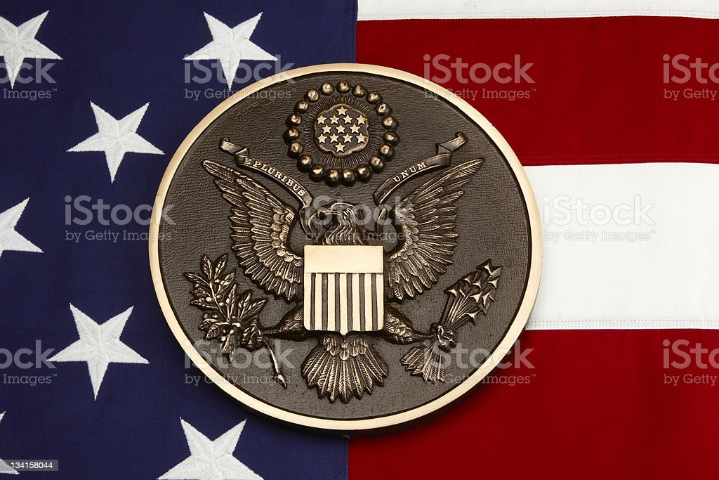 Seal of the United States shot on American flag stock photo