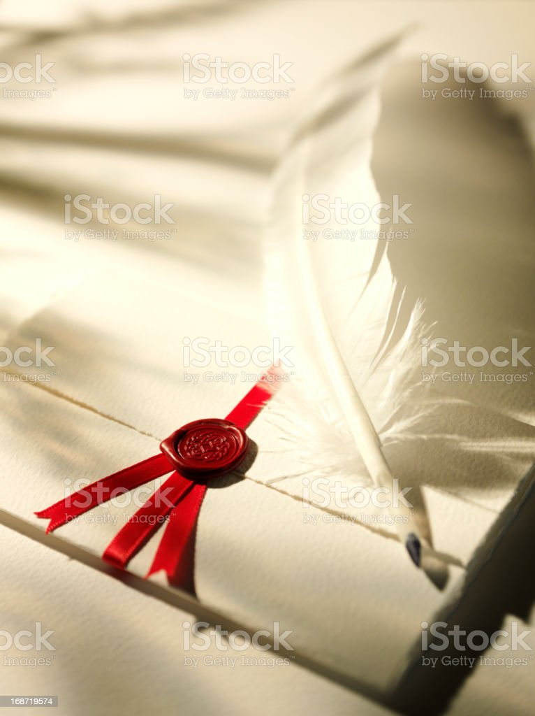 Seal on a Document with Quill Pen stock photo