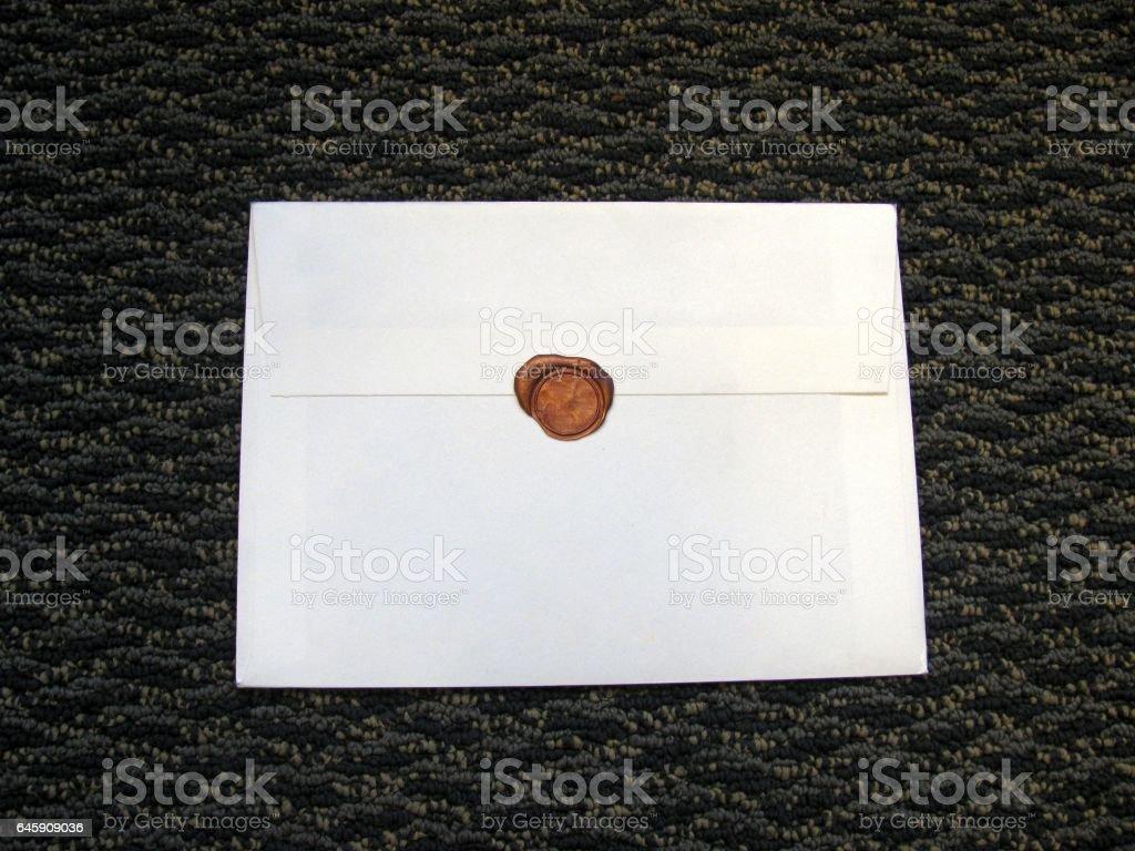 Seal wax on white envelope stock photo