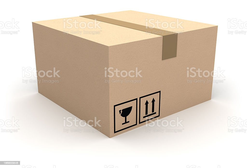 Sealed cardboard box with fragile sign royalty-free stock photo