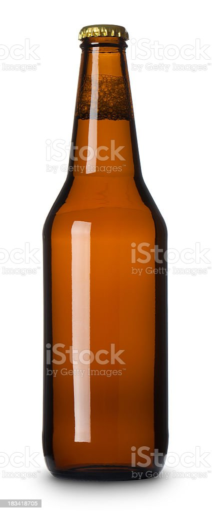 Sealed full brown beer bottle on white background stock photo