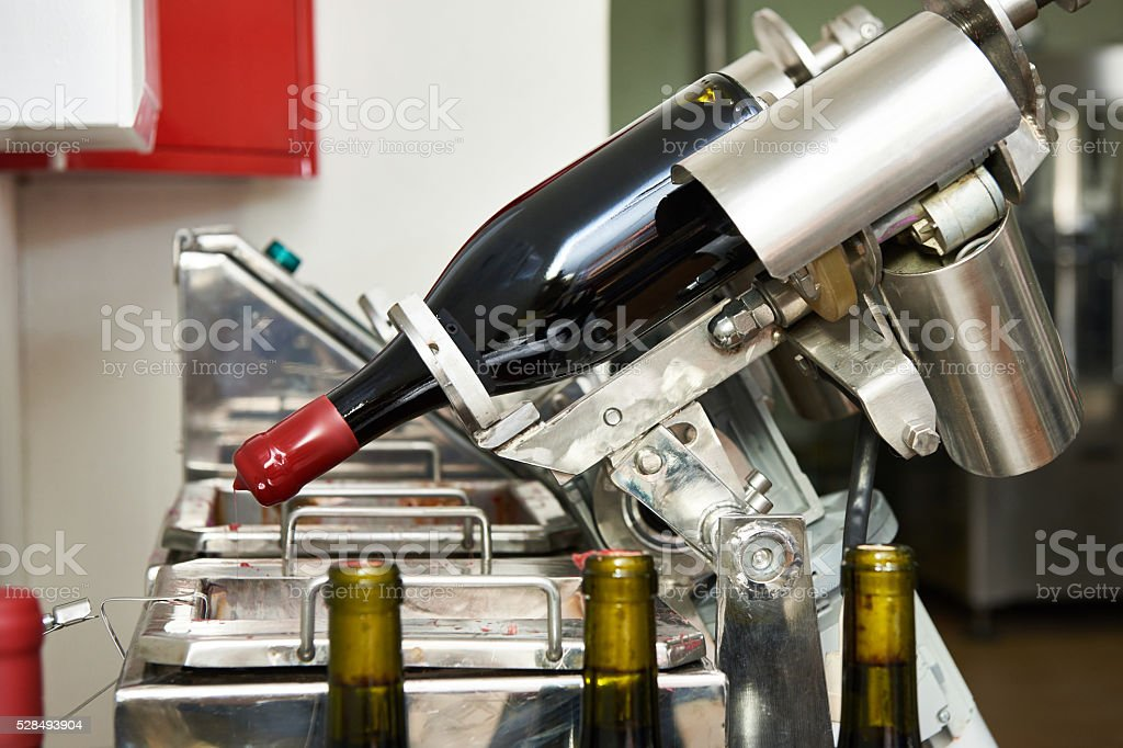 Sealing bottles of wine at winery stock photo