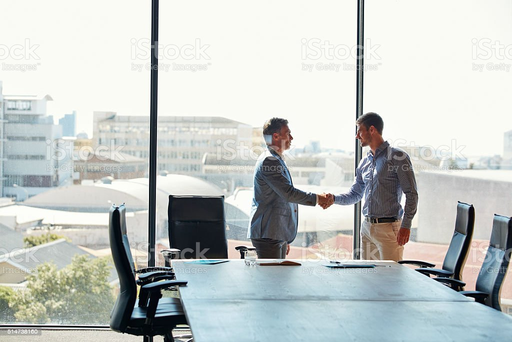 Sealing the deal with a handshake stock photo