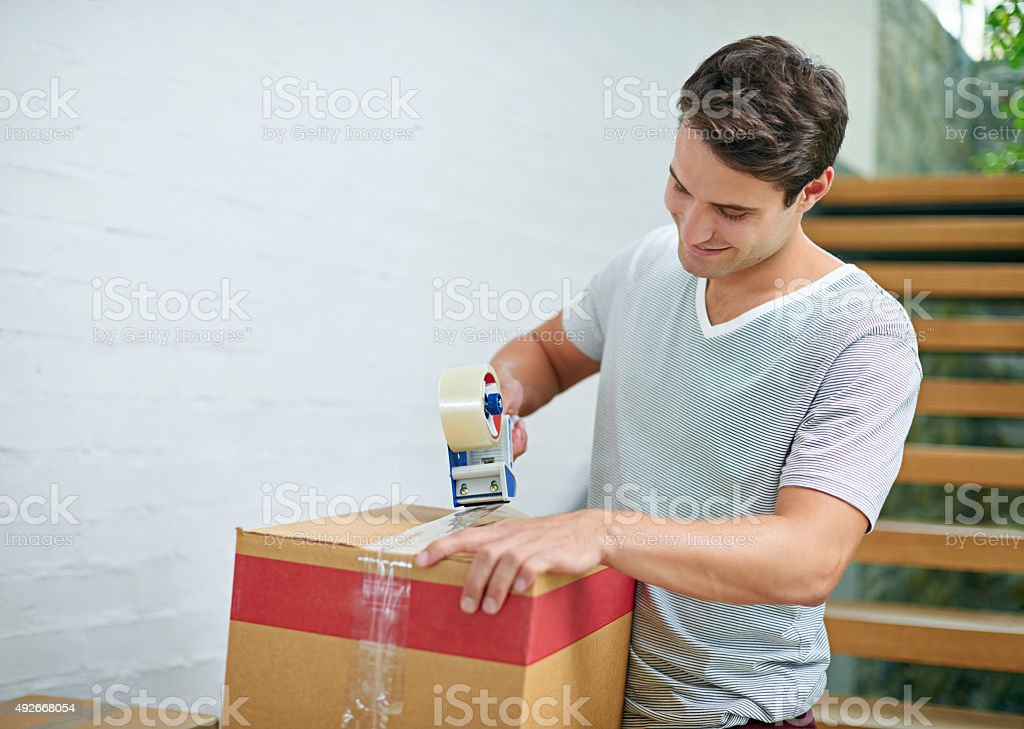 Sealing up the last few boxes stock photo