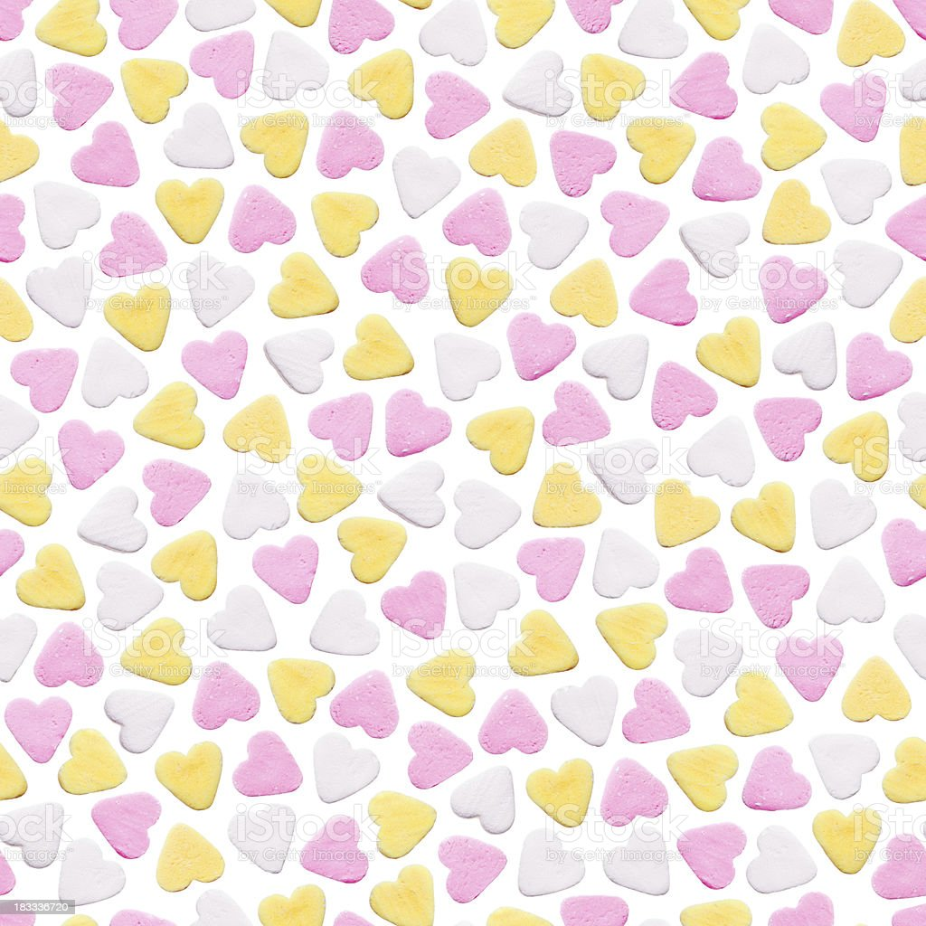 Seamless background with little candy hearts stock photo