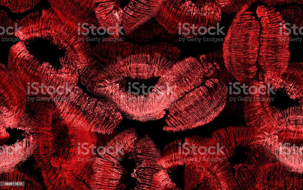 seamless background with red lips imprints on black stock photo