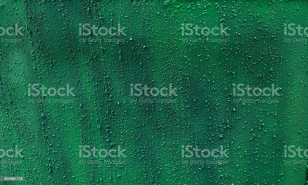 seamless black and green metal background stock photo
